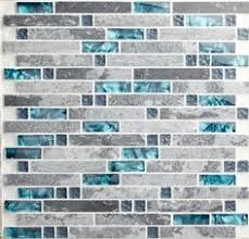 Kitchens Where The Backsplash Is The Main Event Teal - Teal glass tile backsplash
