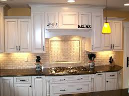 backsplash to match cherry cabinets backsplash with black countertops to match countertop and cherry
