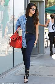 selena gomez puts a stylish spin on high waist jeans and crop top