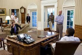 president obama in the oval office office desk desk in oval office obama phones white house