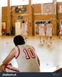 basketball player on bench basketball amateur player waiting bench stock photo 13182604