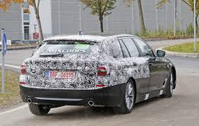 2017 bmw 5 series touring sneaks out with minimal camo