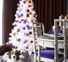 white tree with purple ornaments seasonal