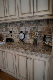 Kitchen Countertops And Backsplash by Cabinets Refinished To A Custom Off White Finish With Heavy Glaze