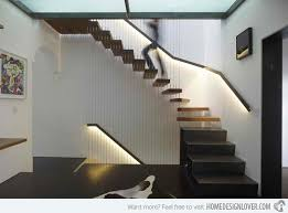 impressive down stairs design love the stone wall down the