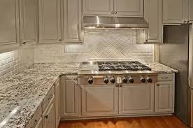 grey kitchen cabinets with granite countertops exposed white brick backsplash black and granite countertop light