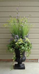 interesting planting combo for an urn entryway plants