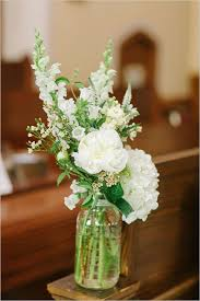 jar flower arrangements are you a or groom church ceremony floral