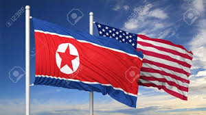Flags And Flagpoles Waving Flags Of North Korea And Usa On Flagpole On Blue Sky