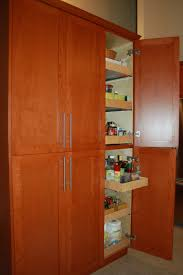 light brown wooden pantry cabinet with six shelves also single