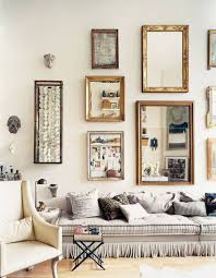 Decorative Living Room Mirrors by Grey Sofa With Ruffles Against Wall Mirrors And Decor In The