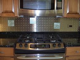 considering stainless steel backsplashes to have bold kitchen