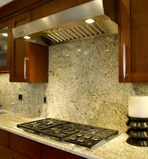 interior brown wooden kitchen cabinet with granite backsplash