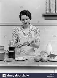 1930 S Kitchen by 1930s Woman Housewife In Kitchen Stock Photos U0026 1930s Woman