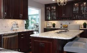 what backsplash looks with cherry cabinets colonial white granite cabinets backsplash ideas