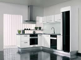fresh cream kitchen with black appliances taste
