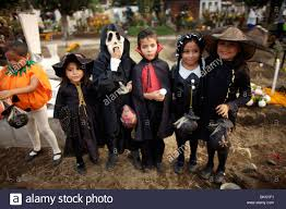 halloween costumes city girls and boys dressed in halloween costumes visit the cemetery in