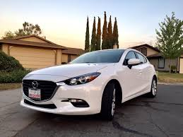 dealer mazda just purchased the last 2017 pearl white mazda 3 touring hatch at