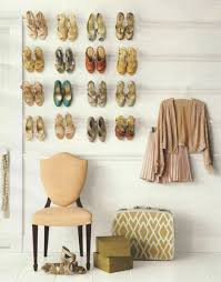 diy extensive white wall mounted shoe racks in girls closet design