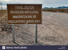 Arizona travel warnings images Warning sign in border area at vekol valley road in sonoran desert jpg