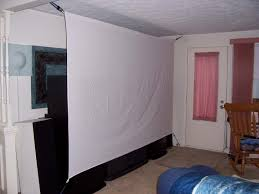 retractable home theater screen diy projector screen made with bed sheets and bungee cord for