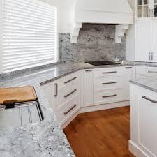 gray kitchen cabinets with white granite white thunder granite kitchen ideas photos houzz