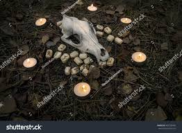 beautiful halloween composition candles tarot runes stock photo