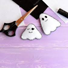 purple and black halloween background two small halloween ghosts diy white and black felt sheets