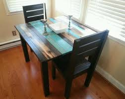 square blue and black color scheme distressed wooden dining table distressed dining table and chairs