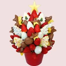 christmas fruit arrangements fruity gift edible fruit arrangements carved and whole fruit