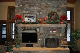 and concrete fireplace mantle shelf with red flower arrangement f