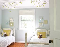 bedroom white bed and tree decoration with small
