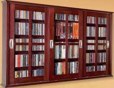 dvd cabinets with glass doors 25 dvd storage ideas you had no clue about binder
