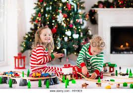 sibling children open presents stock photos sibling