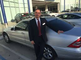mercedes keyes jerome nalbandian posing with one of the cars he s sold me soon