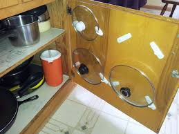 Hanging Pot Rack In Cabinet by Best 25 Pot Lid Storage Ideas Only On Pinterest Storing Pot