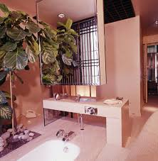 7 rare retro bathroom ideas from the pages of vogue magazine francois catroux 1975 floating medicine chest art deco interior designer bathroom faux plants palm tree decor