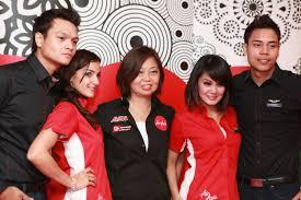 airasia uniform airasia launches new corporate identity