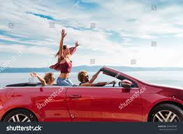 red volkswagen convertible group happy young people waving red stock photo 535042948