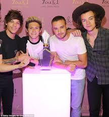 louis tomlinson hints at one direction reunion daily mail
