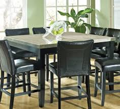 Black Leather Chairs And Dining Table Granite Dining Table Set Flooding The Dining Room With Elegance