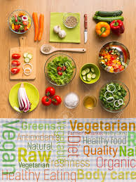 healthy fresh vegetarian food on kitchen table with healthy eating