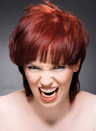 short haircut with a soft neck section red hair