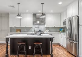 kitchen with black island and white cabinets tips for successfully specifying affordable kitchen cabinets