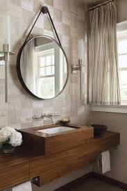 half bath design with wall mounted wooden vanity with towel bars