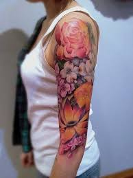 half sleeve watercolor of different flowers arm