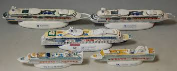 five various souvenir ornaments of cruise ships to include royal