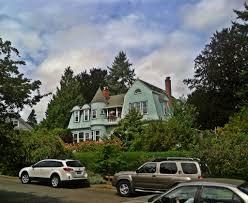 aqua dutch colonial house with turret tacoma wa usa eli
