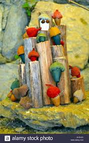 ornamental mushrooms of all the colors rest on wooden logs stock