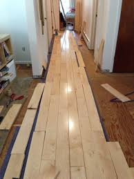 How To Lay Laminate Flooring In A Hallway Learning How To Rack Our Maple Hardwood Flooring Merrypad